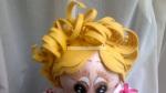 Re. 146 Detalle de los ojos y el peinado de ondas